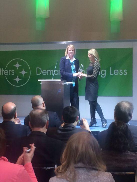 Elizabeth Krear accepts the Woman of Steel Award